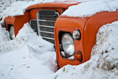 Off-road vehicle. Old SUV neglected in the dirty snow Stock Images