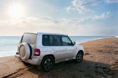 Off-road vehicle on the beach. Off-road vehicle on the  sandy beach Royalty Free Stock Photos