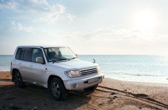 Off-road vehicle on the beach. Off-road vehicle on the  sandy beach Stock Photography