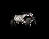 Off road vehicle. Off road 4X$ vehicle on a black background Stock Images