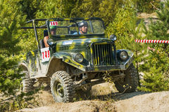 Off-road vehicle brand GAZ -69 overcomes the track Stock Photography
