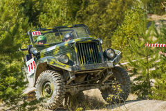 Off-road vehicle brand GAZ -69 overcomes the track Stock Photo