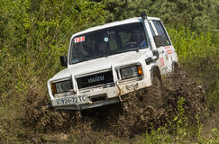 Off-road vehicle brand ISUZU overcomes a pit of mud Royalty Free Stock Photography