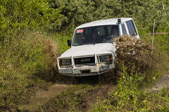Off-road vehicle brand ISUZU overcomes a pit of mud Stock Images