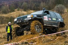 Off-road vehicle brand Jeep Cherokee overcomes a track stock photos