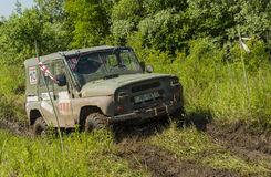 Off-road vehicle brand UAZ overcomes a pit of mud Stock Photos