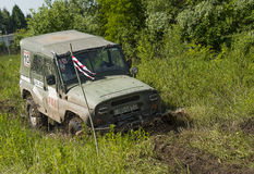 Off-road vehicle brand UAZ overcomes a pit of mud Royalty Free Stock Images