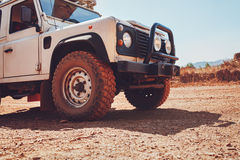 Off road vehicle on country road Royalty Free Stock Photos