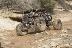 Off Road Vehicle in Creek Bed Stock Images