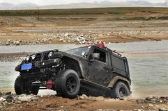 An Off-road vehicle cross river Stock Images