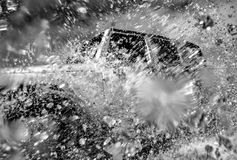 Off road vehicle crossing river Royalty Free Stock Images