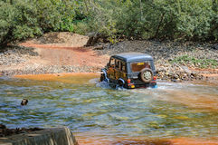 Off-road vehicle crossing a small Indian river Royalty Free Stock Photography