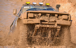 Off-road vehicle and dirt track. Plenty of muddy motorsport.off-road vehicle and dirt track royalty free stock photography