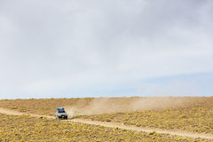Off-road vehicle driving in the Atacama desert, Bolivia Royalty Free Stock Photo