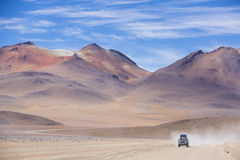 Off-road vehicle driving in the Atacama desert, Bolivia Stock Photo