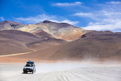 Off-road vehicle driving in the Atacama desert, Bolivia Stock Photography