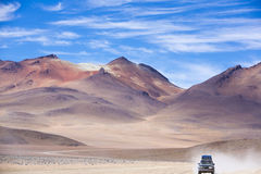 Off-road vehicle driving in the Atacama desert, Bolivia Stock Photos