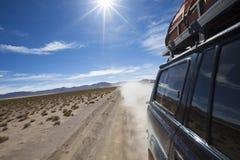 Off-road vehicle driving in the Atacama desert, Bolivia Stock Image