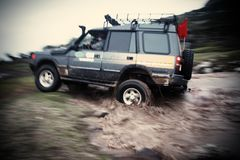 Off Road Vehicle. Driving Off Road Car in the mud very strong vehicle Royalty Free Stock Photos
