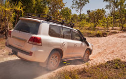 Off-road vehicle driving through dry riverbed. Northern Territor Stock Image