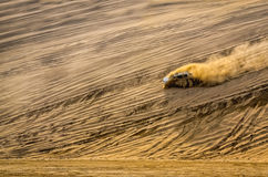 Off-road vehicle driving in the sand desert Stock Photos