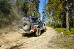 Off road vehicle going up the hill Stock Image