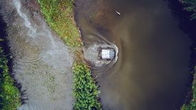 An off-road vehicle sails on the river. aerial above view top royalty free stock photography