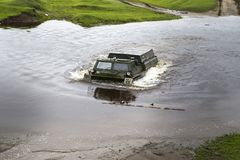 Cross-country vehicle crosses the river Stock Images