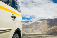 Off-road vehicle in mountain scene in Leh,India. Royalty Free Stock Photo