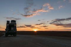 Off-road vehicle oldtimer sunset Royalty Free Stock Photo