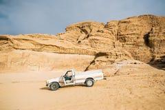 Off-road vehicle with open door stand in Jordan desert. Wadi Rum, Jordan royalty free stock photos