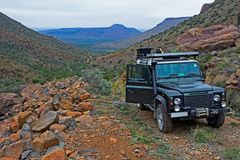 Off-road vehicle on rocky mountain trail. In Karoo, South Africa royalty free stock image
