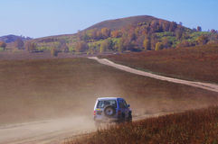 Off-road vehicle running in the grassland Royalty Free Stock Images