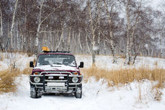 Off-road vehicle in winter forest Stock Photo