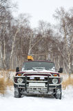 Off-road vehicle in winter forest Stock Image