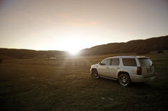 Off-road vehicles. In a field at sunset stock photo
