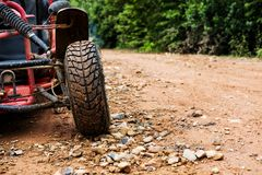 Off-road wheel on dirt road Royalty Free Stock Photos