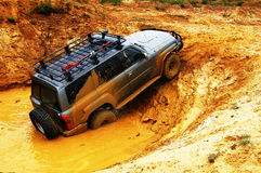 Off roading thrill. 4x4 Off roading thrill in the mud royalty free stock photo