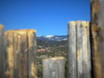 Santa Fe ski basin, the Southern tip of the Sangre de Cristo Mountains, visible through a fence royalty free stock photography