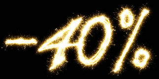 -40% off sign. Made by sparkler.  on a black background. Stock Photography