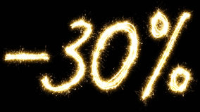 -30% off sign. Made by sparkler. Isolated on a black background. Stock Images