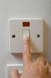 On or off switch. Finger turning white light switch on or off Stock Images