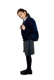 Off to school. A young schoolgirl with her rucksack, on white background Stock Photos