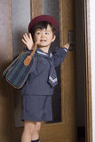 Off to school. Young asian boy leaving for school stock image