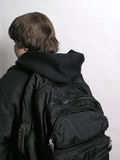 Off to School with bookbag. On back Stock Photo