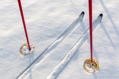 Off-track skis and ski poles on snow Royalty Free Stock Image