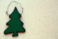 Christmas tree decoration on a off white background. On a off white background and green wooden Christmas tree decoration on the left  side Royalty Free Stock Photos