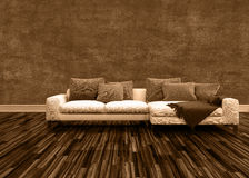 Off White Couch with Pillows in an Empty Room Royalty Free Stock Photography