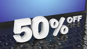 50%  off white 3D numbers on black laptop. Keyboard Royalty Free Stock Images