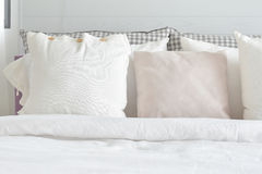 Off white pillows setting on bed with english country style bedding. Decoration royalty free stock photos